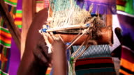 African Man Weaving on a Colorful Hand-loom