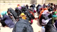 African migrants staying in a refuge in the alKaram region of the city of Misurata in Libya are taken to different refuge camps on May 9 2015