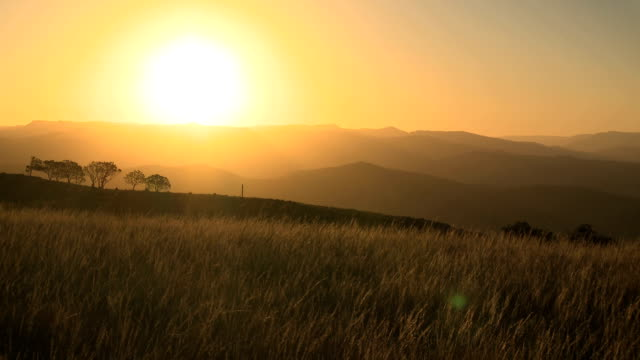 African savannah and mountains sunset timelapse
