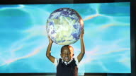 MS African-American boy holding world / Miami, Florida, United States