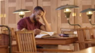 LD African-American male student studying in the library