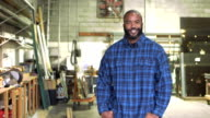 African-American man in plate glass warehouse