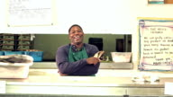 African-American man working in fish market