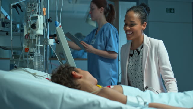 African-American mother visiting her son in the intensive care