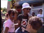 AfricanAmerican Radio DJ dances with kids on the street