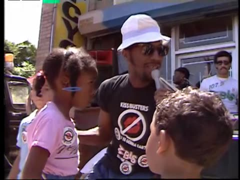 AfricanAmerican Radio DJ dances with kids on the street