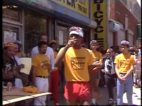 AfricanAmerican Teen raps to a big crowd that joins in on street