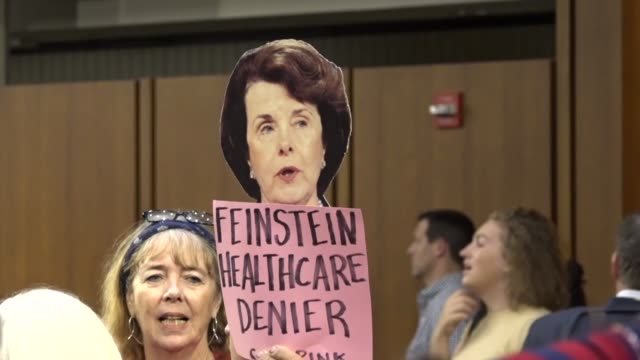 After a news conference led by Senator Bernie Sanders and others concluded a supporter is seen holding up a cutout of California Senator Dianne...
