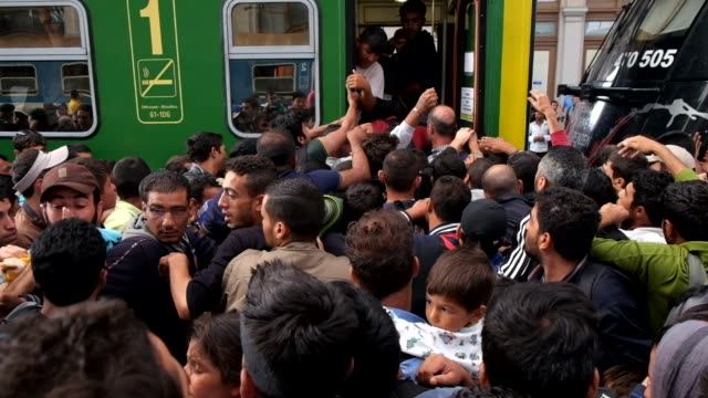 After a twoday lockout from Keleti train station in central Budapest refugees rush to board trains they hope will bring them closer to Germany...