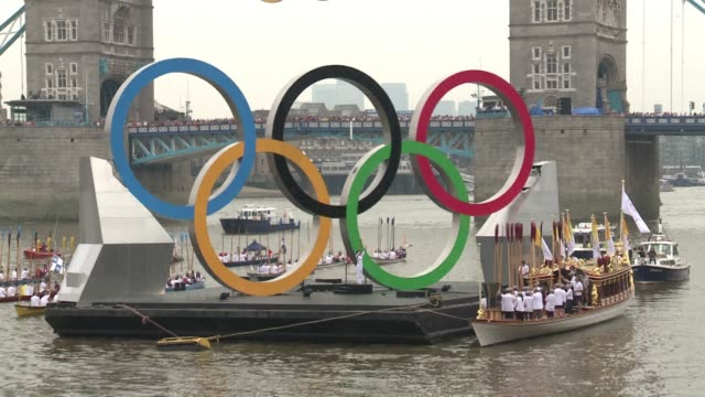 After an epic journey around the UK over 70 days the Olympic flame reached the end of its journey Friday on board the royal barge Gloriana London...