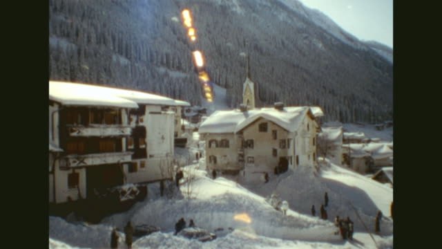 after the madlein avalanche destroyed parts of the village the filmer made these rare shots of the snowslide total views of the village houses capped...
