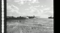 After they receive instructions the crew of a Type 2 flying boat takes off and and performs a scout and observation mission in support of a convoy