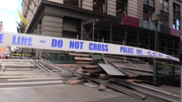 Aftermath of Scaffolding Collapse on Broadway and Prince Street FDNY truck wind blowing street sign and police tape