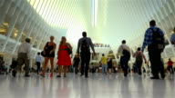 Afternoon rush hour people traffic at the Westfield World Trade Center / Westfield WTC is a shopping center at the World Trade Center complex /...