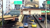 Afternoon rush hour traffic entering and bypassing the Ed Koch Queensboro 59th Street Bridge / East 60th Street and 2nd Avenue midtown Manhattan New...