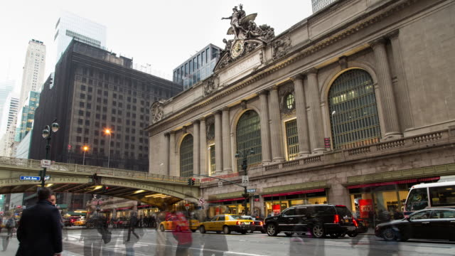 Afternoon time lapse of Grand Central Terminal (NYC) with foot and vehicle traffic along E 42nd St and vehicle traffic along the Park Avenue Viaduct