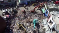Aftershocks rattle the survivors of a devastating Indonesia earthquake that killed nearly 100 people as officials urgently appeal for medicine and...