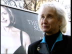 London Westminster Age Concern poster on hoarding on side of van along past Houses of Parliament Sally Greengross intvwd in front of poster Linda...