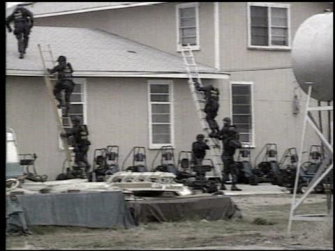 Fbi Agents Climbing Ladders Outside Mount Carmel Center