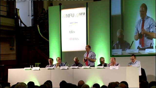 Farmers' protest at proposed milk payment cuts Westminster rally / NFU meeting General views of NFU meeting including audience members listening and...