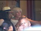 Agyness Deyn talks with friends at bar pitti in Grenwich Village in New York 07/01/11