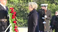 Ahead of her meeting with Donald Trump British Prime Minister Theresa May lays wreath at Arlington's cemetery