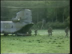 UN aid and relief supplies ARCHER CLIPREEL LOCATION MS Troops running out of back of helicopter on exercise PAN LR