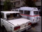 Aid Convoy Vinkovci MS Hospital with bomb damage MS Ditto PAN RL to damaged ambulance in front MS Ambulance with sirens sounding along PAN MS Injured...