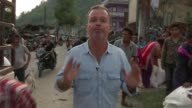 Aid starts to arrive in remote areas following earthquake Legs of women walking along track **Bahadur interview partly overlaid SOT** Villagers along...