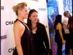 Aimee Mullins female friend entering on red carpet at The Paris Theatre in NYC Mullins telling friend to come out to pose for photographs for press