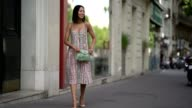 Aimee Song wears a multicolor striped dress nude heels and a green bag outside the Valentino show during Paris Fashion Week Haute Couture Fall/Winter...