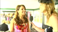 Aintree 2009 Ladies Day INT Rooney interview SOT Looking forward to seeing some well dressed boys and girls / On wearing Roberto Cavalli dress / Will...