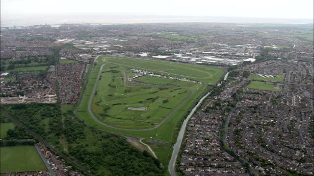 Aintree Racecourse  - Aerial View - England,  Sefton,  Aintree Village helicopter filming,  aerial video,  cineflex,  establishing shot,  United Kingdom