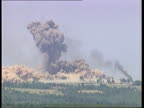 ITV Smoke rising in Kosovo village held by the Serbs and being bombarded by NATO as explosion seen Explosion seen in village Smoke and dust rising...
