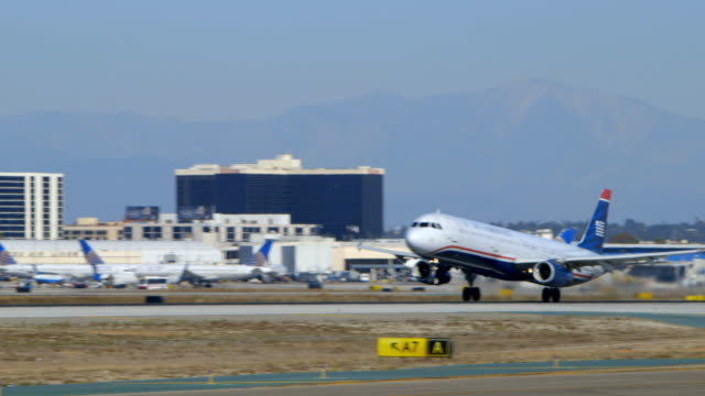 US Air Airbus A321 takes off from LAX, daytime