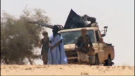 Air Algerie plane crashes in Mali T19081203 Jihadists standing in front of vehicle Militants around truck with artillery weapon mounted on the back...