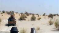 Air Algerie plane crashes in Mali T19081203 Convoy of Jihadi fighters through desert Vehicles of convoy along