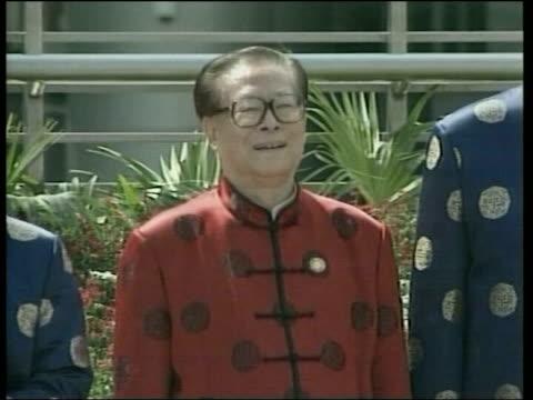 Air attacks / ground operations POOL via REUTERS Shanghai President George WBush wearing chinese jacket Chinese President Jiang Zemin INT World...