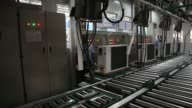 Air conditioners move along the assembly line at the Carrier Midea Pvt manufacturing facility in Bawal Haryana India on Tuesday May 27 An employee...