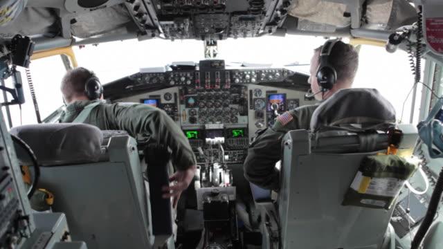 TS Air Force Pilots in cockpit during flight, Colorado Rockies, Colorado, USA