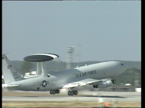 US Air Force radar aeroplane taxiing on run way and taking off.