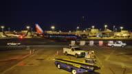 Air plane driving on runway at Hartsfield Jackson International Airport in Atlanta GA Night shot