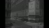 CU air raid warning siren on lamppost in Manhattan NYC / VS people begin to get off streets walk inside buildings / LS steeple of Trinity Church tilt...