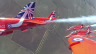 Air to Air point of view cockpit shots RAF Red Arrows planes flying in formation streaming white smoke performing aerobatics on February 25 2015 in...