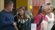 Air traffic control system stretched to limit on busiest travel day ENGLAND West Sussex Gatwick Airport INT Various shots of passengers queuing in...