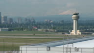 Air Traffic Control Tower Seq mountains and cityscape in bg