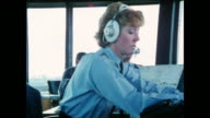 MONTAGE Air traffic controllers clearing planes for takeoff / United Kingdom