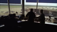 Air traffic controllers monitor aircraft activities at a military airbase.