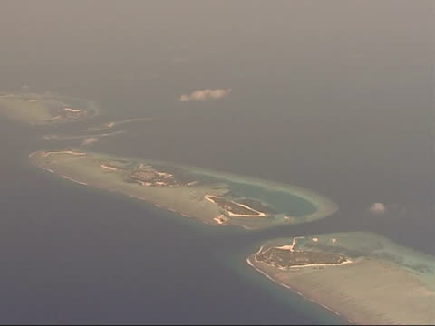 Air views of Islands More of above / Settlements and small forest areas on atolls