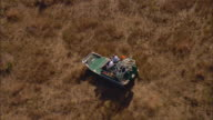 AERIAL WS Airboat moving across Everglades wetland / Florida, USA